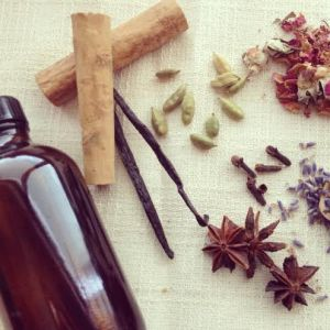 DIY body oil bottle with herbs